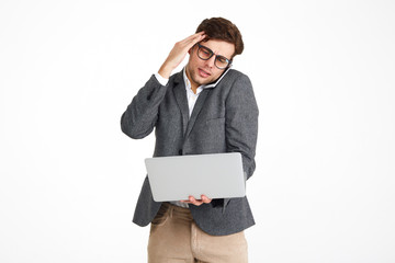 Portrait of a puzzled businessman in eyeglasses