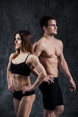 Fitness sporty healthy couple man and woman on a dark background