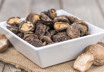 Wooden table with Dried Shiitake, selective focus