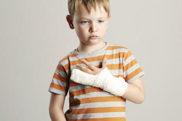 sad little boy.child with a broken arm