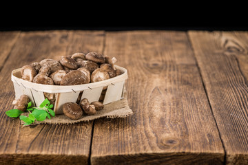 Wooden table with Shiitake mushrooms, selective focus