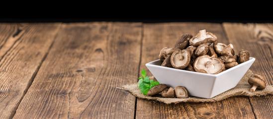 Portion of Raw Shiitake mushrooms, selective focus