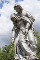 Statue of a man holding up a woman