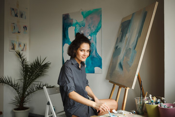 Woman draws picture in home studio. Concept of arts therapy