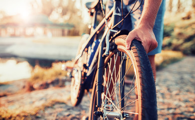 Cyclist riding a bike in the park. Sport and recreation concept