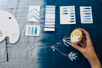 Female Artist Making Textile Print with Potato Stamps