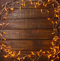 Wooden background with bright lights with a free space for text or product demonstration