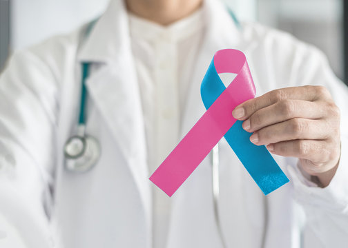 Pink blue ribbon awareness, symbolic bow color for Infant birth defect, Sudden Infant Death Syndrome (SIDS), pregnancy Loss on helping handin doctor's hand