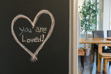 You Are Loved Written On Kitchen Chalkboard