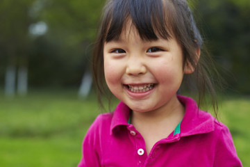 close up of little asian girl smile