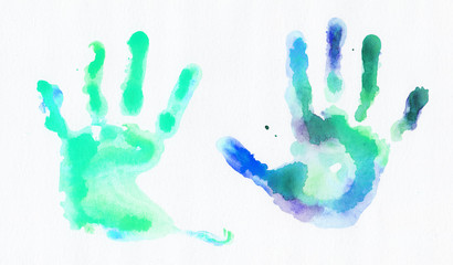 Watercolor handprints over white background
