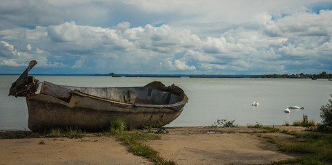 Old forgotten rusty boat on Baltic seashore on Baltic spit