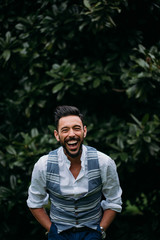 Portrait of a stylish man laughing