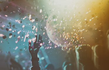 Disco ball with lights and confetti.