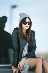 Outfit inspiration - closeup sitting girl wearing touque and sunglasses