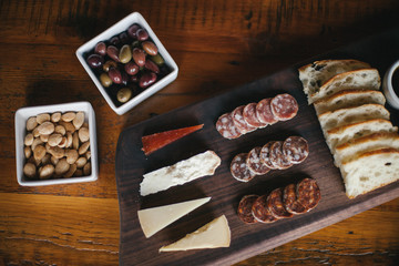 Aeiral view of a charcuterie and cheese board on a table