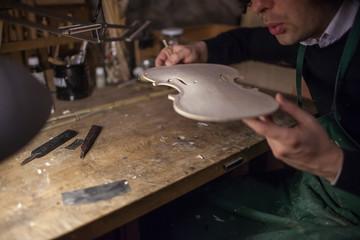 Violin maker at work .