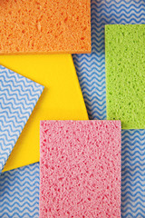 colourful sponges and cleaning clothes ready for spring cleaning