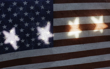 Grunge US flag in shadow, with star shaped lights on it