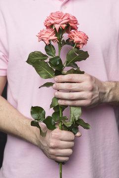 Man holding a bouquet