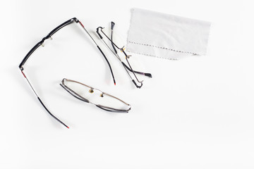 eyeglass on fabric background.