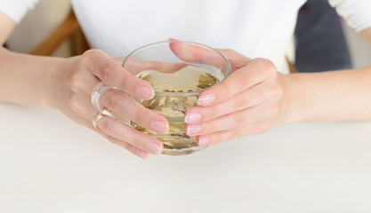 Herbal tea in woman hands