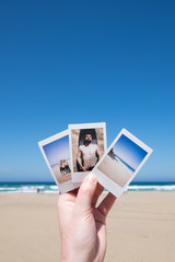 Hand Showing Instant Pictures From Holiday