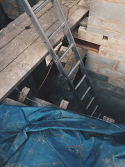 Looking down at a ladder and planks on a building site