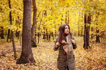 Tourist walking through the autumn forest