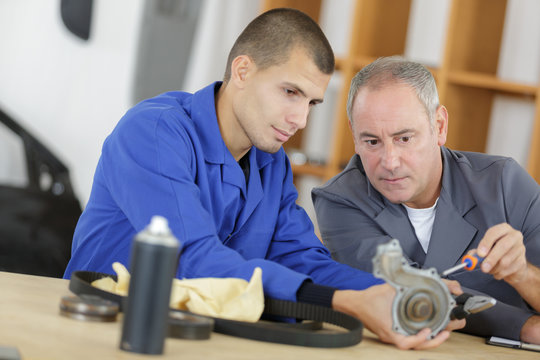 manager with apprentice holding bearing