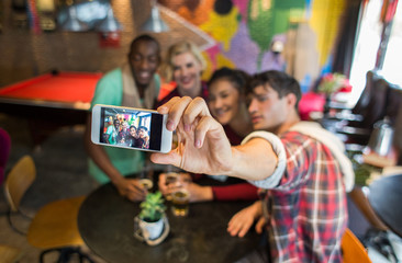 Group of friends having great time and talking a selfie