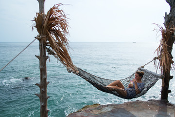 Woman Lying in Hammock and Enjoying the View
