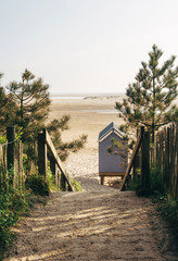 Beach hut and path to beach at sunrise. Wells-next-the-sea, Norfolk, UK.