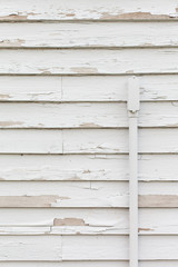 Weathered wood siding painted white