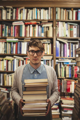 Young man in a book store