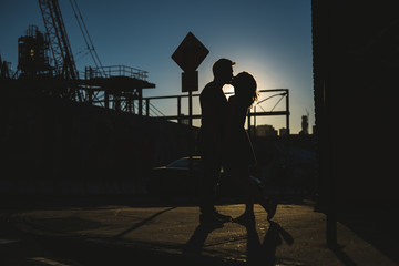 Young couple silhouette kissing in the city
