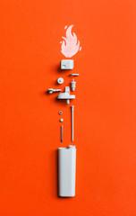 White disassembled lighter  on orange/red background