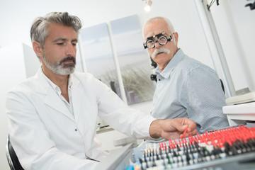 doctor testing different eye test lens