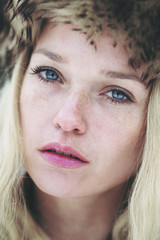 Beautiful freckled woman with blue eyes