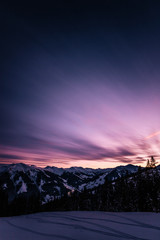 snowcovered austrian alpine winter landscape at sunset