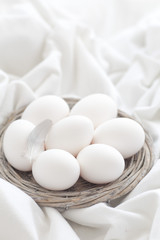 White shell eggs in a twig basket