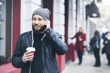 Young man talking on phone in urban environment