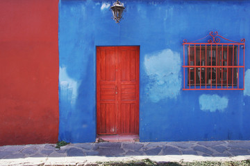 Bright red and blue house in San Miguel de Allende, Mexico