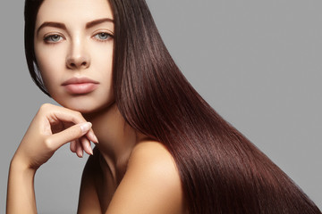 Beautiful yong Woman with Long Straight brown Hair. Sexy Fashion Model with smooth gloss Hairstyle. Keratin treatment