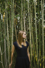 Girl Standing in Bamboo Forest