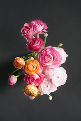 Bunch of pink and orange ranunculus flowers