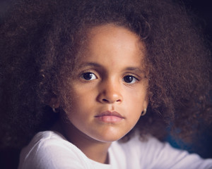 Closeup portrait of thoughtful young girl with frizzy hair