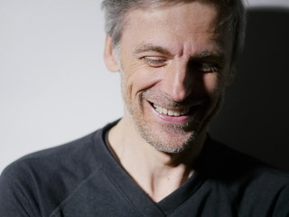portrait middle-aged man laughing