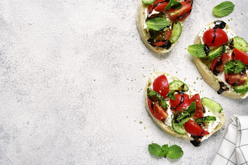Toasts with feta,tomato,cucumber and mint.Top view with space for text.