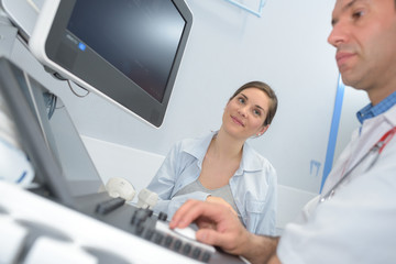 doctor and patient ultrasound equipment diagnostics sonography